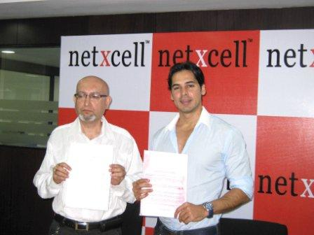 Mr.Debasis Chatterji, CEO, Netxcell Ltd (left) and Mr.Dino Morea, Director, Clockwork Mobile (Right) at the signing ceremony for managing mobile content for Clockwork Mobile