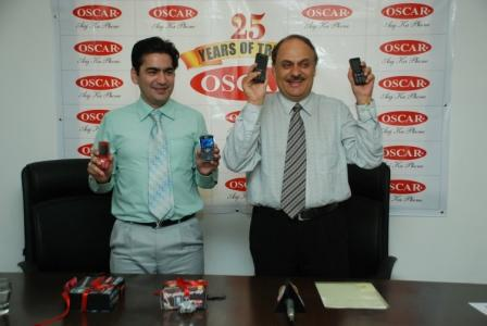 Mr. Suresh Wadhwani Executive Director with the new phones